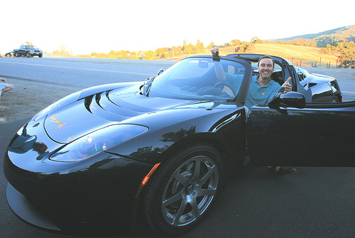 The sleek and green Tesla Roadster.  Photo by Jurvetson