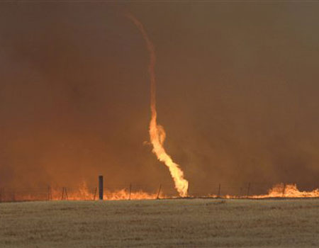Already responsible for the destruction of 6 homes and over 6200 acres, as well as a death, extreme wildfires continue to ravage Texas. AP/The Reporter-News, Ronald W. Erdrich